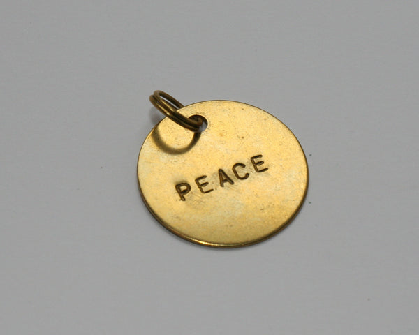 Hand stamped brass tag PEACE