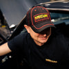 Man wearing 2020 Mecum Men's Black and Red Carbon Hat Front