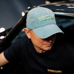 Man wearing 2020 Mecum Men's Blue Kelley Hat