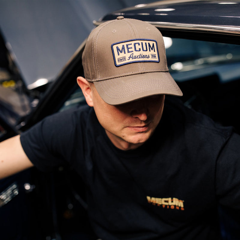 Man wearing 2020 Mecum Men's Grey Throwback Hat