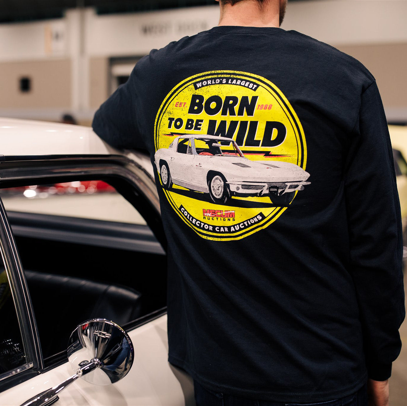 Man wearing 2020 Mecum Men's Born To Be Wild Long Sleeve T-Shirt