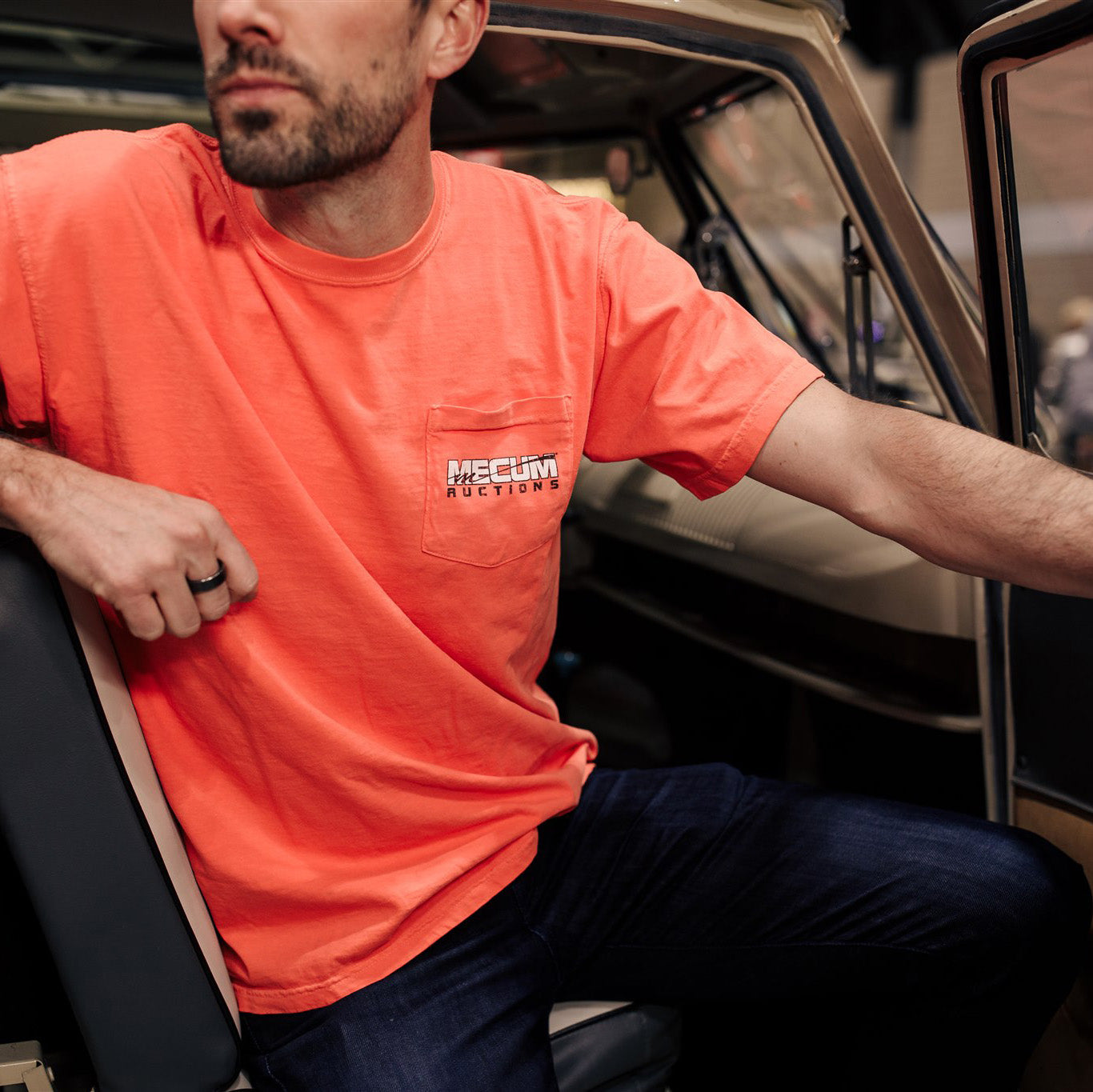 Man wearing 2020 Mecum Woman's Enjoy the Ride T-Shirt