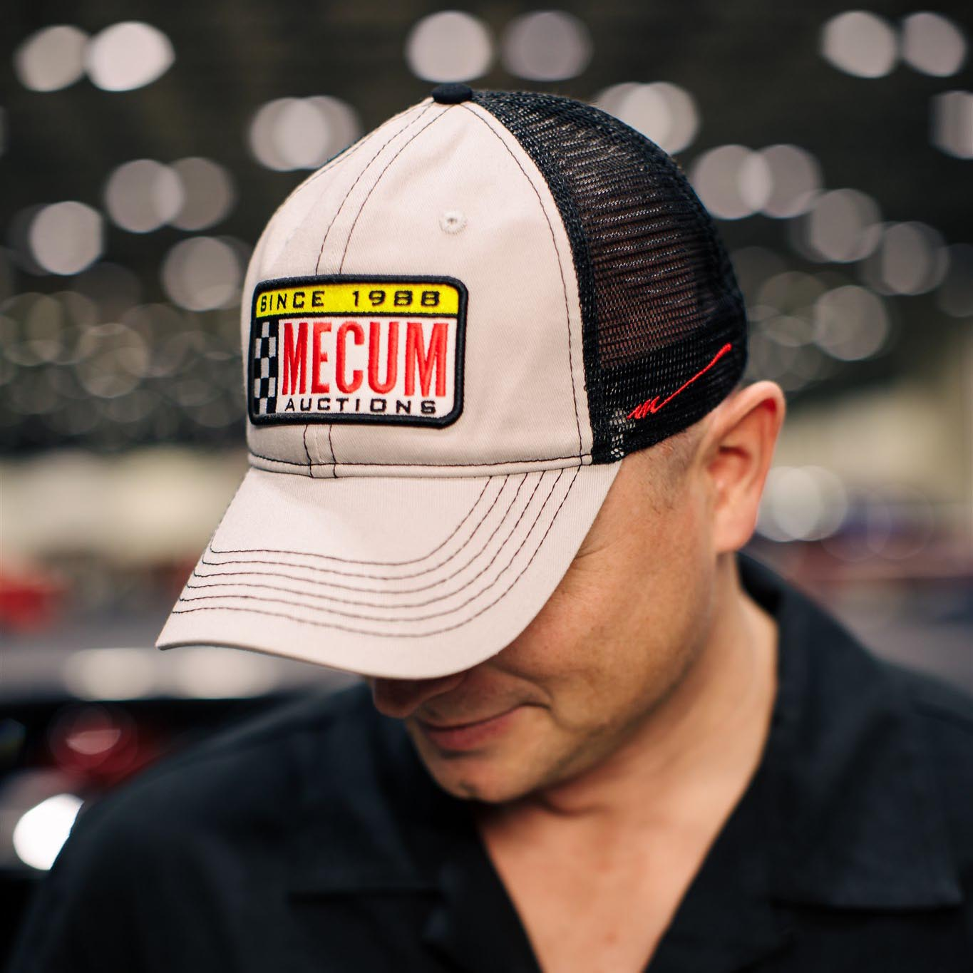 Man wearing 2020 Mecum Men's Gray Race It Hat
