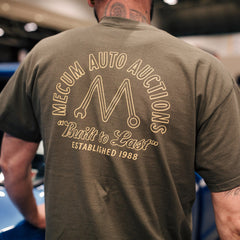 Man wearing 2020 Mecum Men's M Wrench T-Shirt