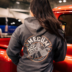 Woman wearing 2020 Mecum Men's Heather Grey Full Zip Hooded Sweatshirt