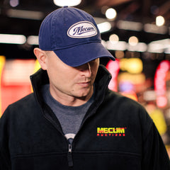 Man wearing 2020 Mecum Men's Navy Swoop Hat Front