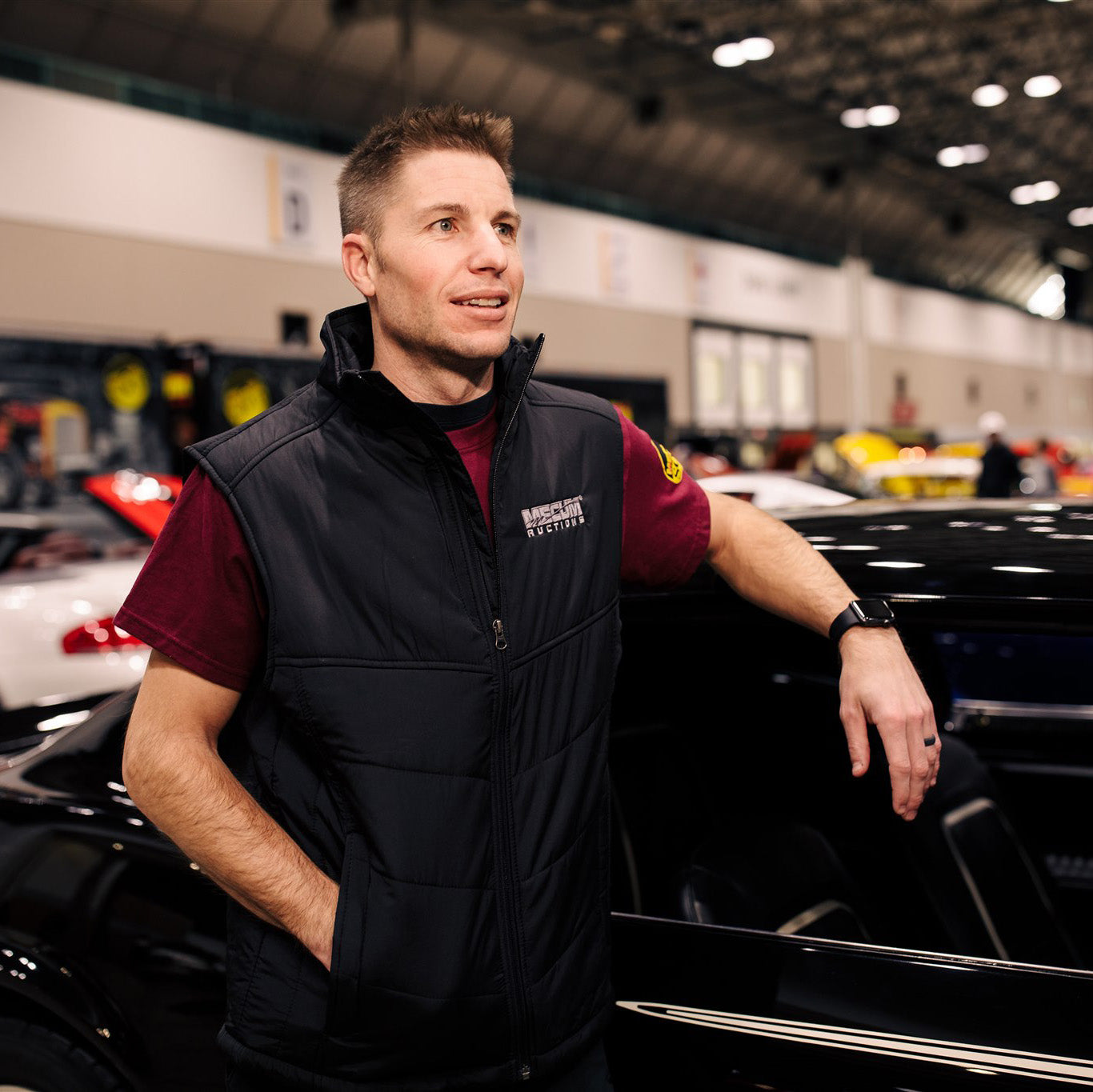Man wearing 2020 Mecum Men's Logo Vest