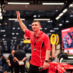 Man wearing 2020 Mecum Men's Red Sport Polo