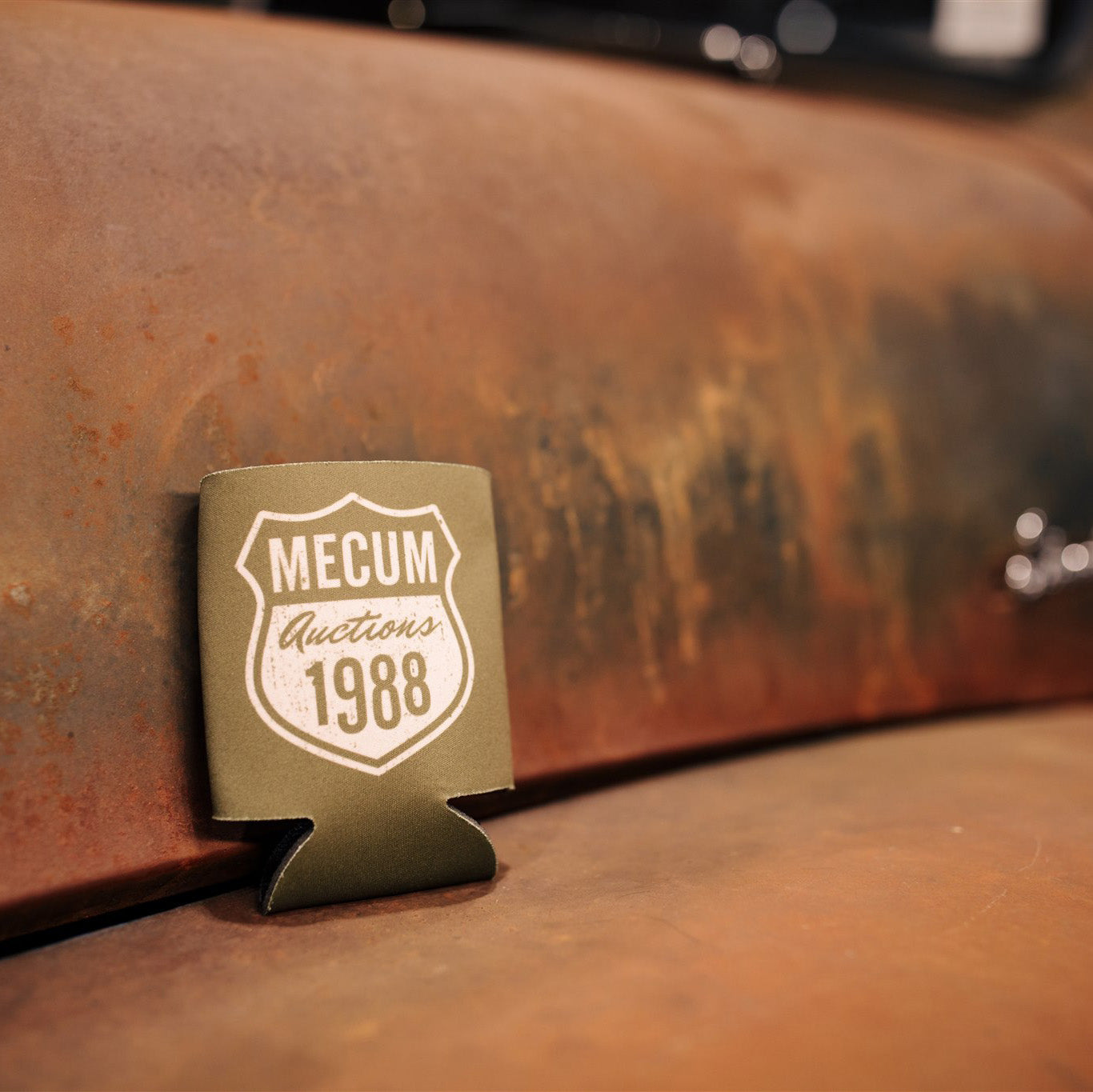 front of mecum auctions 2020 route 88 koozie on rusty truck