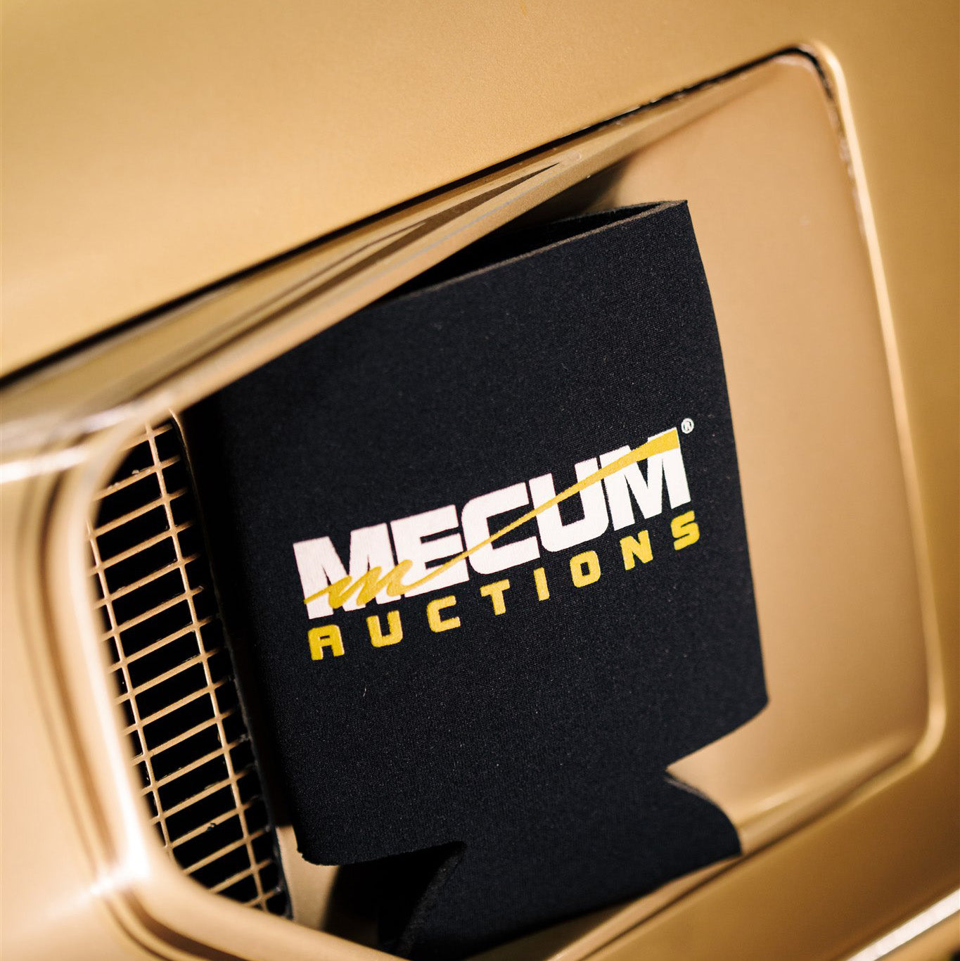 rear of mecum auctions 2020 shifted koozie on gold car hood