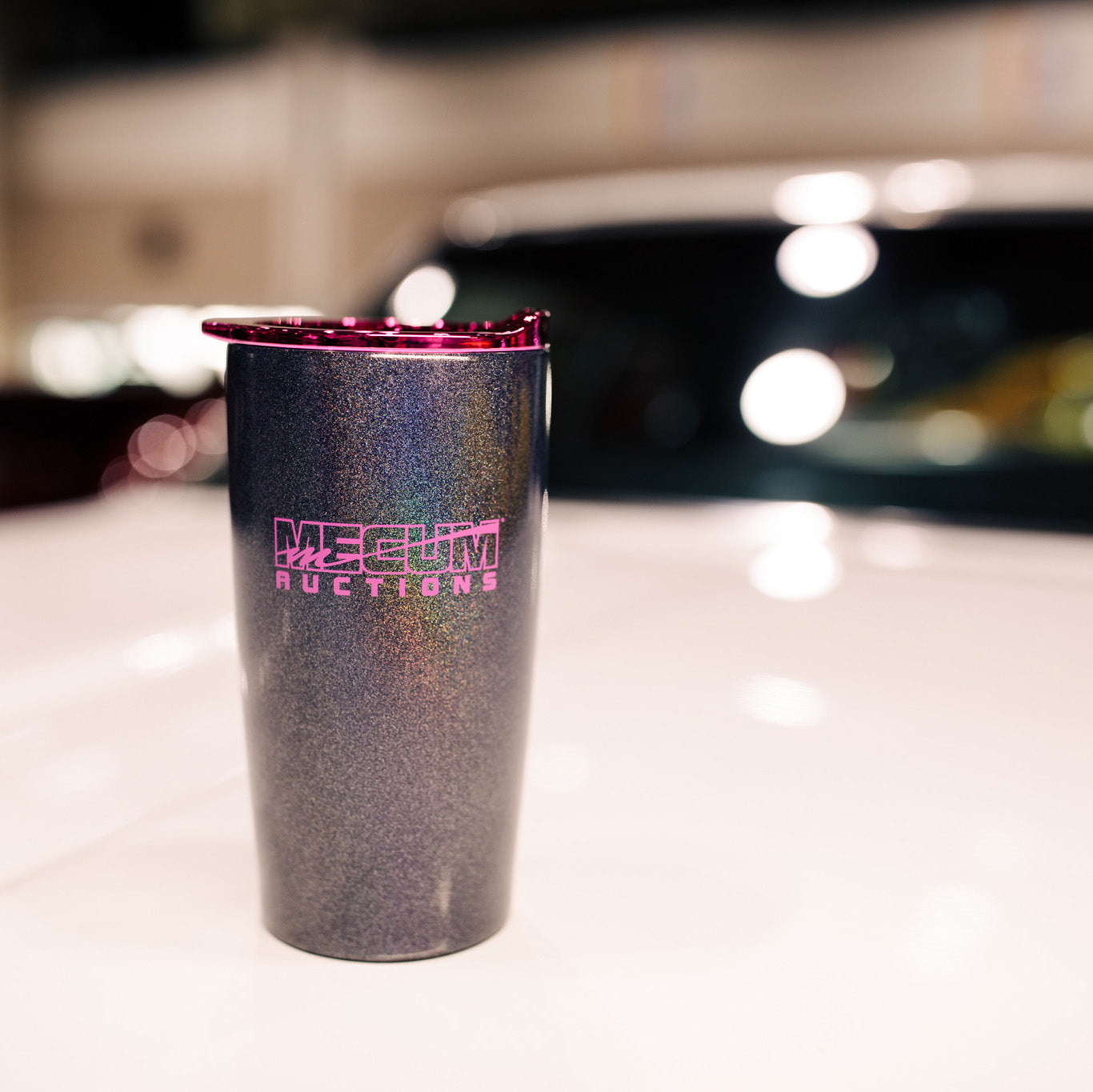 mecum auctions 2020 glitter tumbler on white car hood