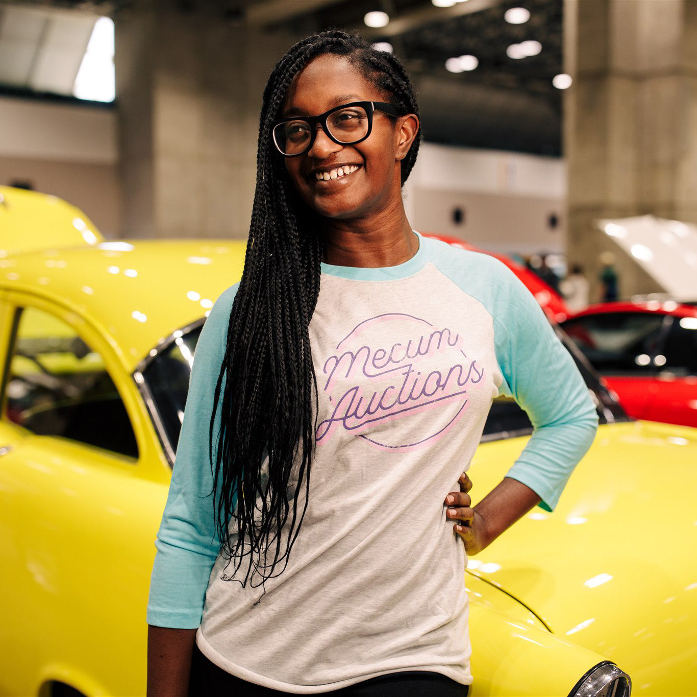 Woman wearing 2020 Mecum Woman's Circulate Raglan T-Shirt
