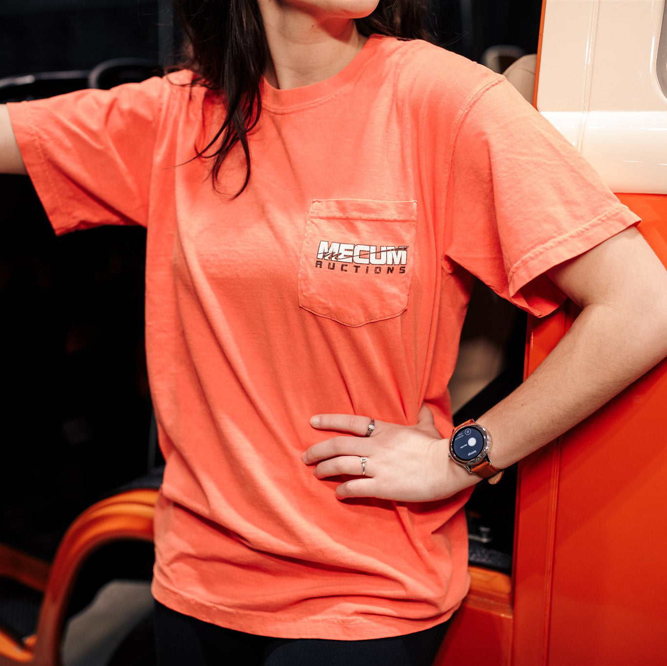 Woman wearing 2020 Mecum Woman's Enjoy the Ride T-Shirt