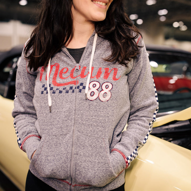 Woman wearing 2020 Mecum Women's Impact Full Zip Hoodie
