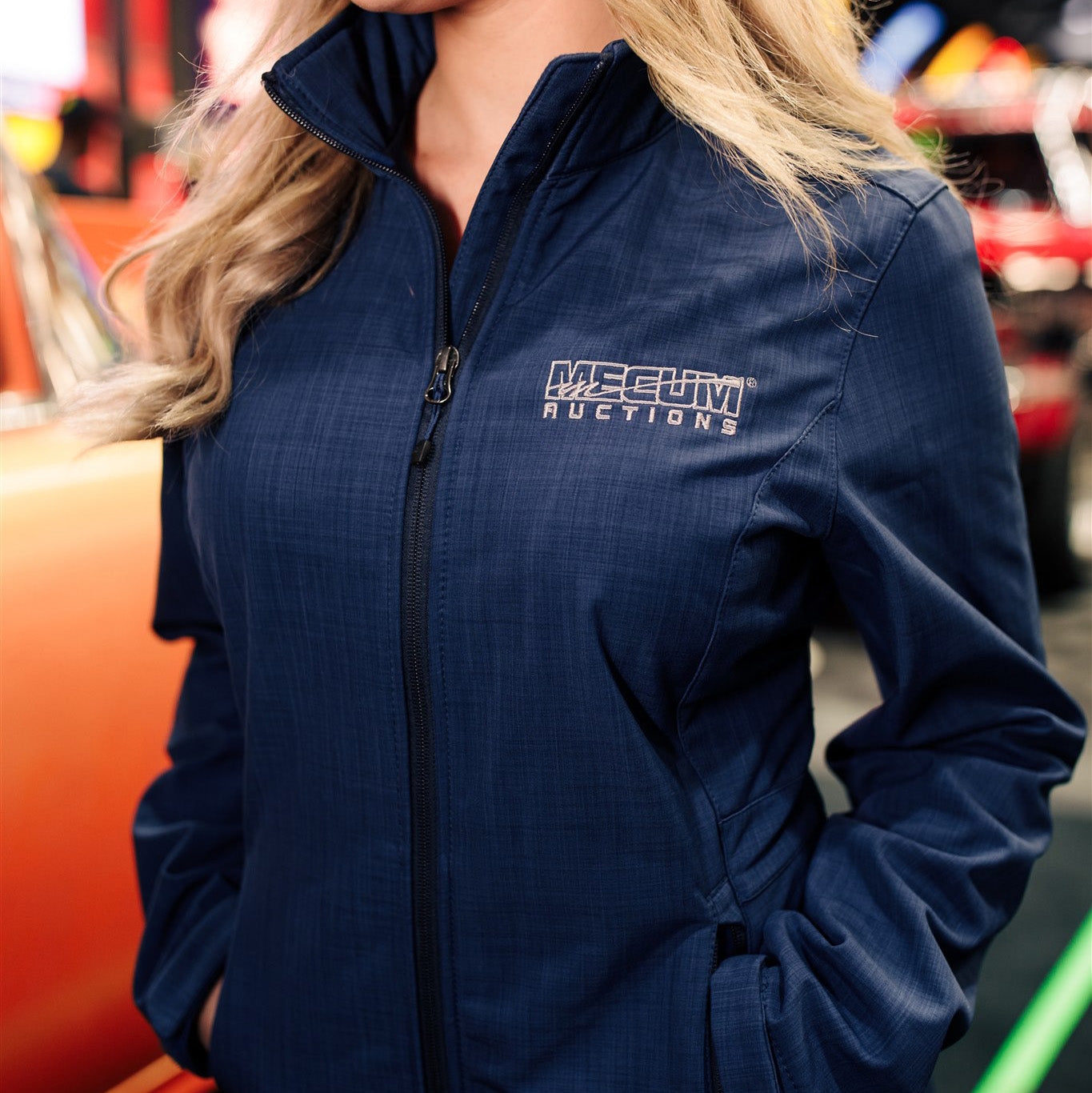 Woman wearing 2020 Mecum Woman's Logo Full Zip Jacket