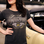Woman wearing 2020 Mecum Woman's Override T-Shirt