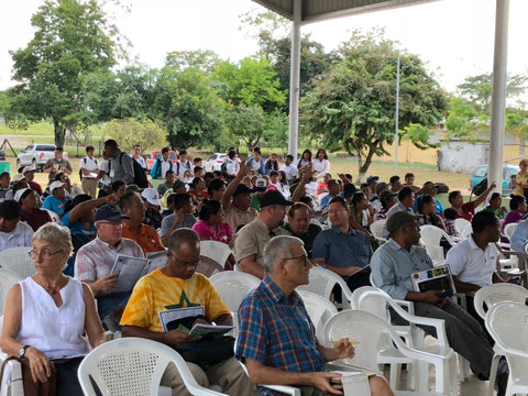 A large crowd listening to speakers at the Tropical Agriculture Conference