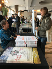 Nasha Winters signing books at 2018 Eco-Ag Conference