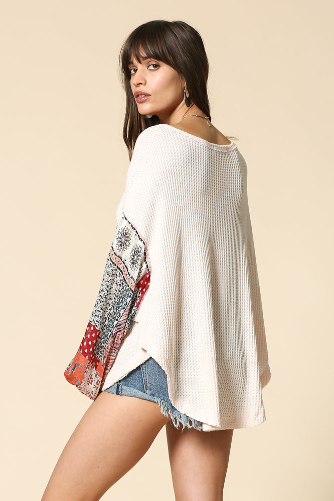 Thermal top with paisley print puffy arms