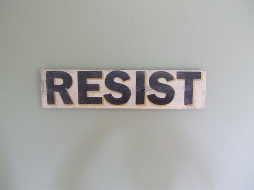 Wooden Sign in Block Letters: RESIST