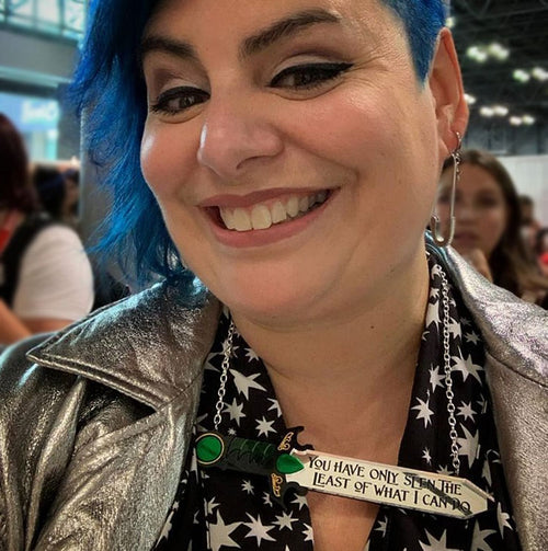 "holly black wearing ""You Have Only Seen The Least I Can Do"" acrylic necklace"