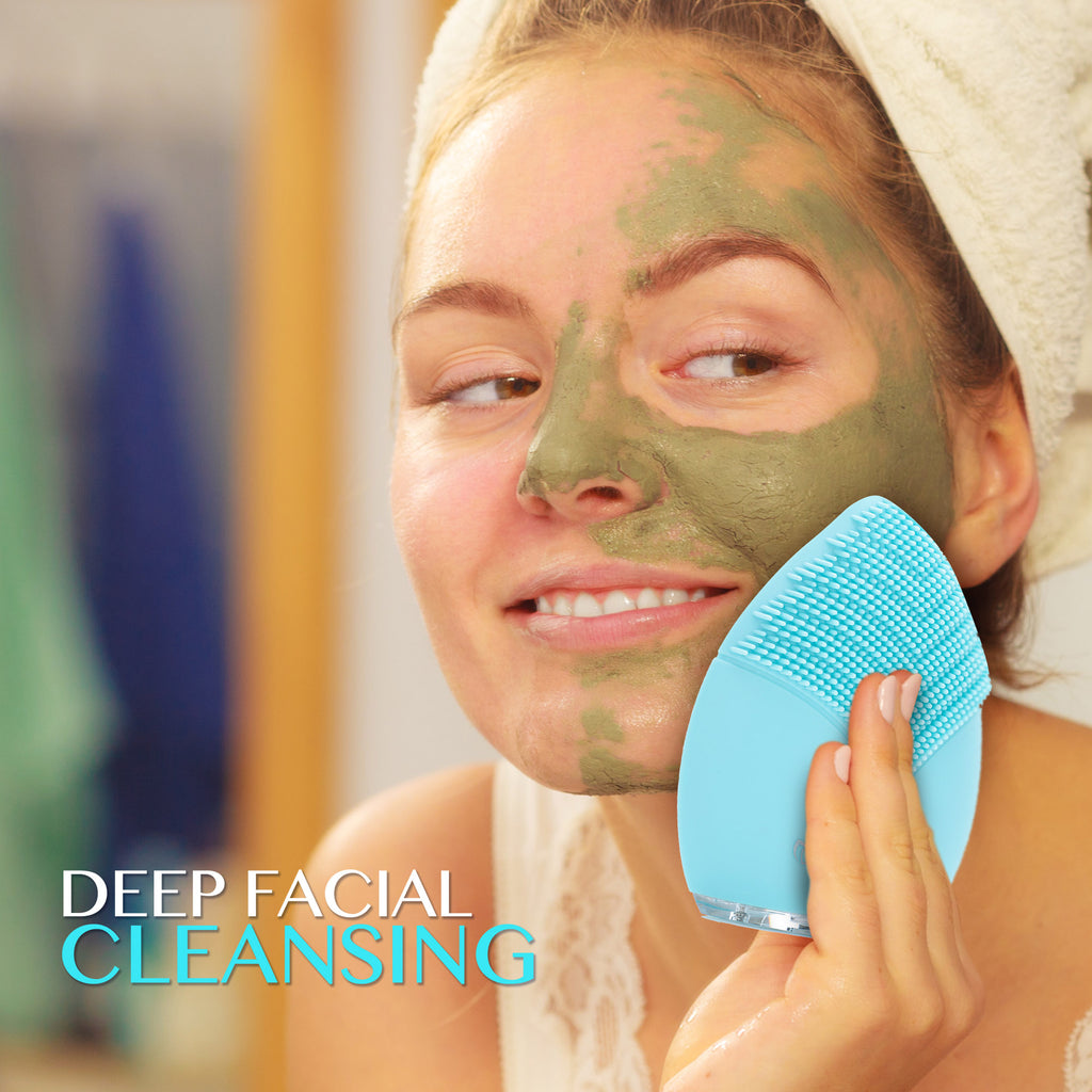MINT Biology - woman using MINTSonic facial cleansing brush with face mask