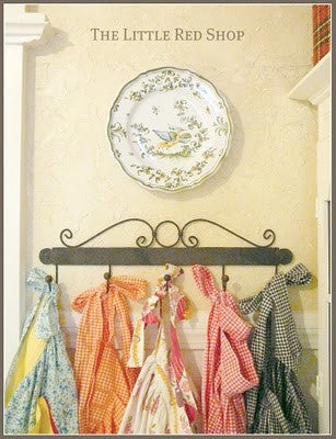 Vintage Aprons in Kitchen by The Little Red Shop