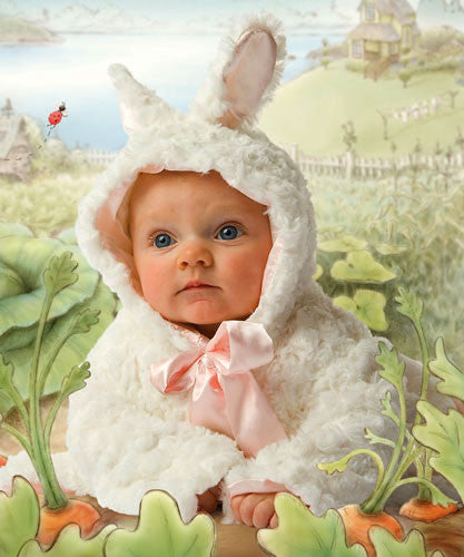 Baby wearing Bunnies by the Bay's Original Cuddle Coat with a Cricket Island Watercolor backdrop