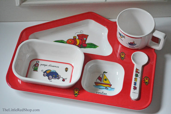 Baby Cie Baby Travel-themed Dish set featuring planes, trains, and automobiles