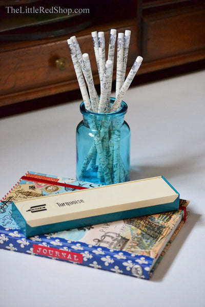 Vintage aqua pencil case and turquoise Belgian apothecary jar with a Paris journal