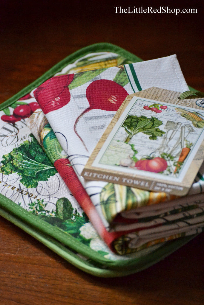 Stack of Michel Design Works From My Garden Kitchen Towels and Potholders featuring Colorful Vegetables