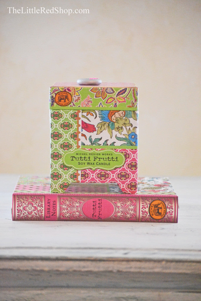 Michel Design Works Pretty Pink Bohemian Candle Box sitting on Tuttie Frutti Library Notes Notecard Gift Set