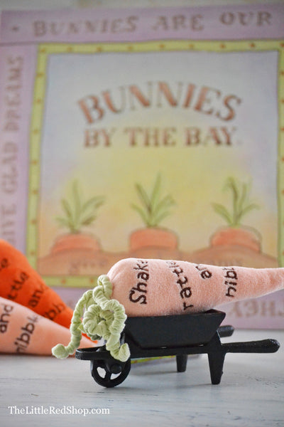 One Peach Bunnies by the Bay's Carrot Baby Rattle in a Little Wheelbarrow