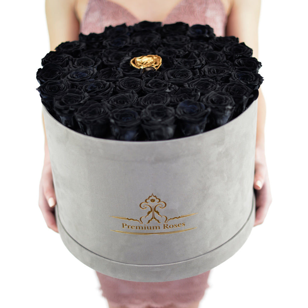 luxury black roses in velvet grey box with single gold rose