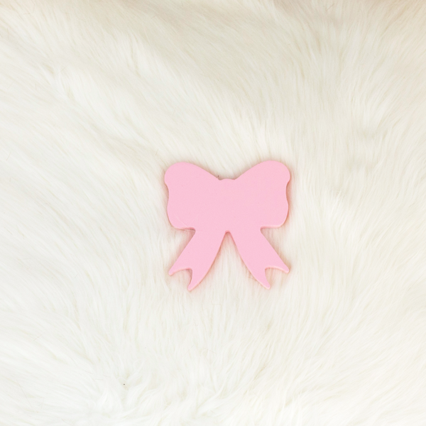 PYC Pretty Yum Co Pink Wooden Bow Wall Hook. Perfect for a baby's nursery or kids room.
