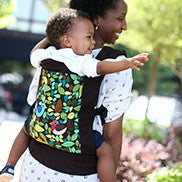 mother with baby on back in tweet boba baby carrier
