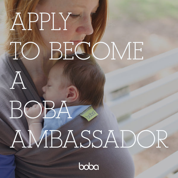 Mother wearing a baby in a boba wrap. Text overlay: Apply to become a Boba Ambassador.