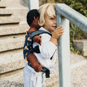 Child wearing a Bear Cub doll Boba Mini Baby Carrier