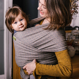 Mother wearing baby in Rain Boba Infant Wrap Carrier
