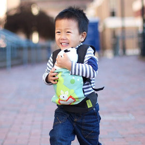 Little girl laughing while wearing her doll in the kangaroo boba mini doll carrier