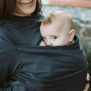 Mother wearing a grey Boba Hoodie over a Boba Baby Carrier.