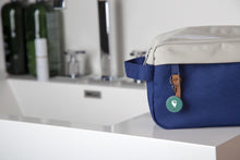 Blue dopp kit with green TrackR pixel