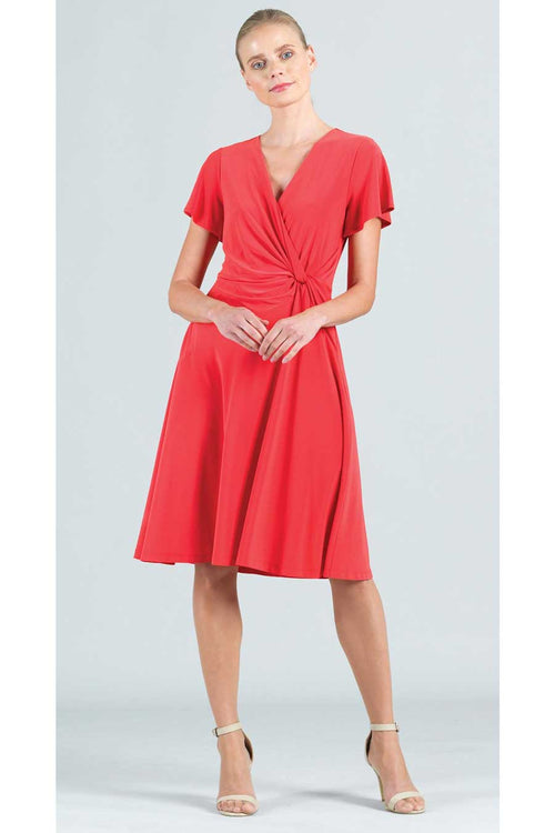 The Solid Front Twist Dress from Clara Sunwoo is a flattering, ready to travel dress by an American clothing brand.