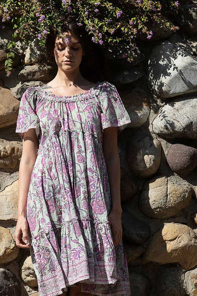 The Inara Dress from the Fox & the Mermaid is made from cotton voile and features an elastic neckline so it can be worn on or offer the shoulder.