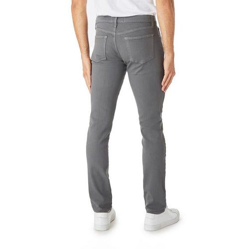 A slim fit tapered jean, comfy around the hips, slim through the leg, and tapering to a narrow leg opening.