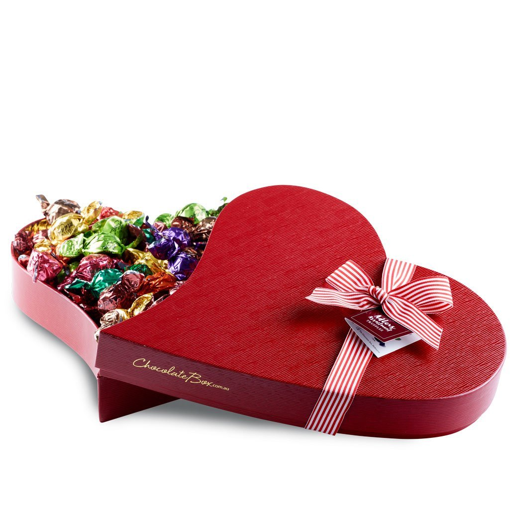 Adlers assortment large heart shaped keepsake box, lid opened with twist-wrapped chocolates inside.