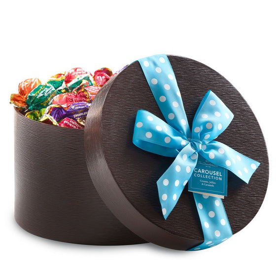 Carousel assortment 1 kilo round keepsake brown box with blue and white spotty ribbon