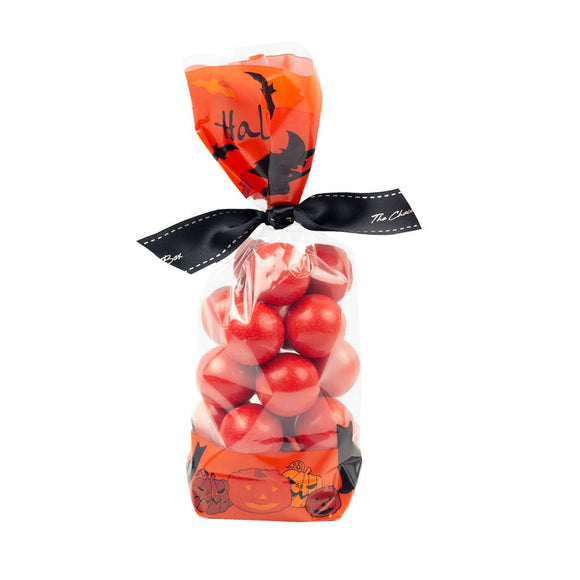 giant orange balls in printed orange and black halloween design cello bag.