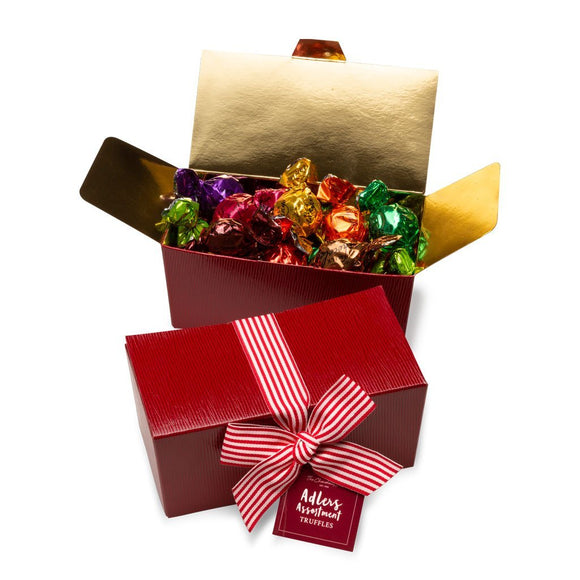 Adlers chocolates ballotin shaped chocolate box with gold Christmas ribbon and tag