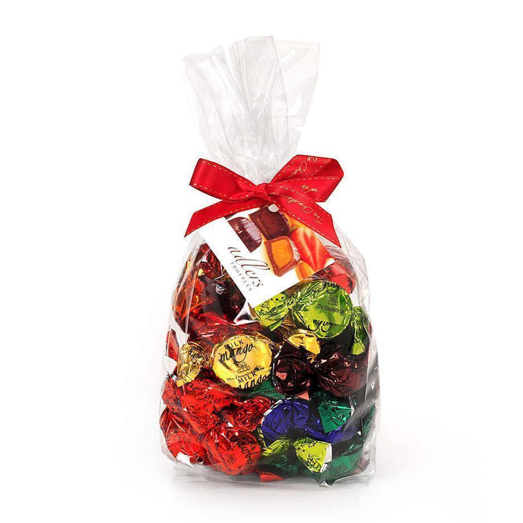 loose adlers assortment twist wrapped truffles in a variety of coloured foils in a clear cello bag with red satin ribbon and tag